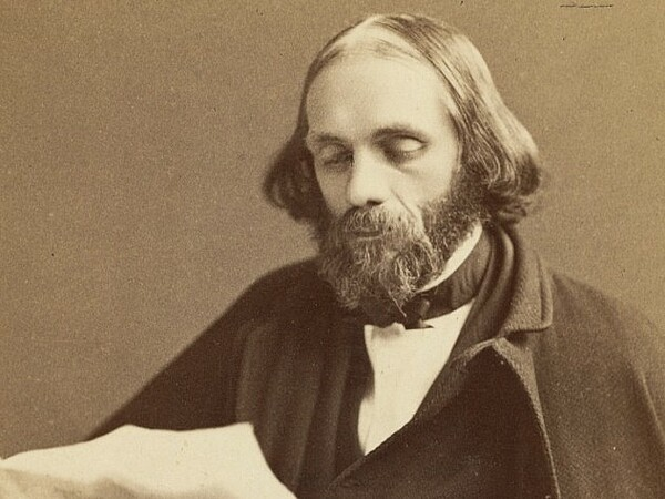 A sepia-toned Edward Everett Hale from 1870, he's bearded and balding in a black coat