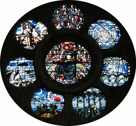Rose window; seven circular images surround an eighth, giving an idea of what the Brick Moon's interior looks like